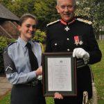 Lord Lieutenant presenting Lauren Ellis with a certificate