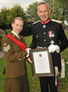 Lord Lieutenant presenting Lauren Wright with a certificate
